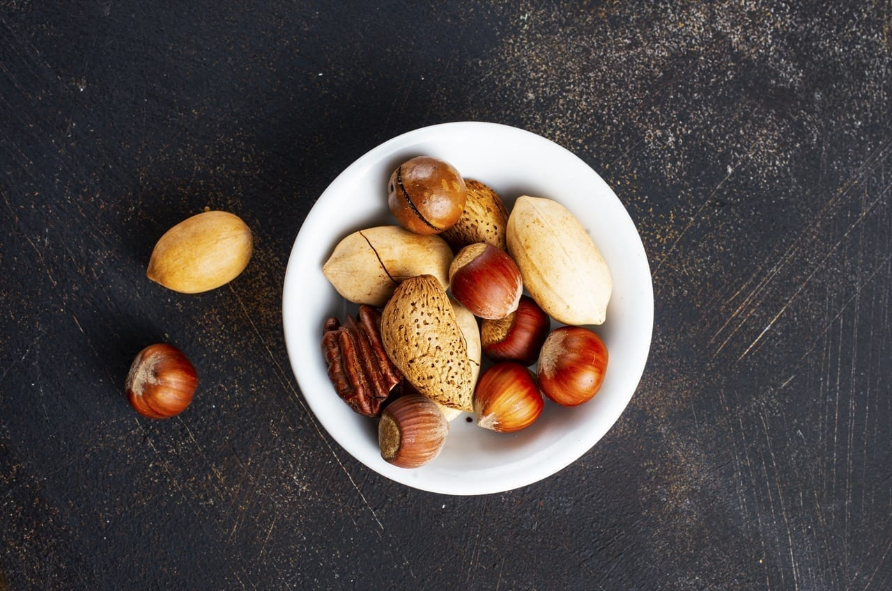 nuts in bowl, mix nuts in white bowl